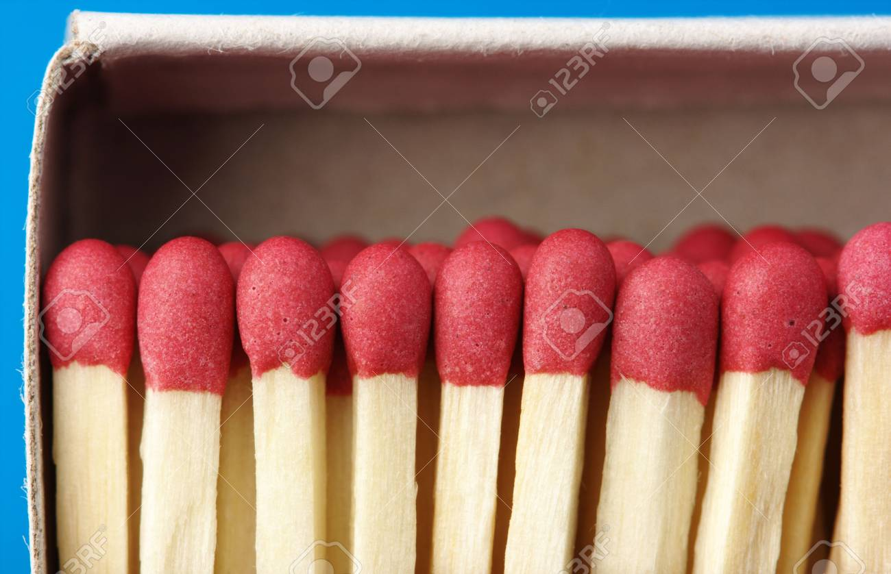 Red matchsticks in the box on blue background, shallow DOF Stock Photo - 5886329