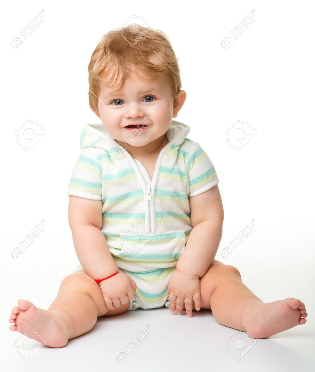 Happy child is sitting on floor, isolated over white Stock Photo - 10346067