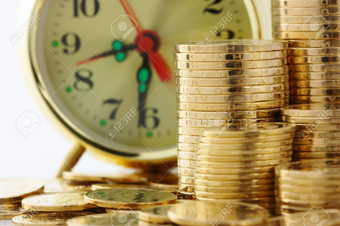 Old-fashioned clock dial on golden coins background, time is money concept Stock Photo - 11102146
