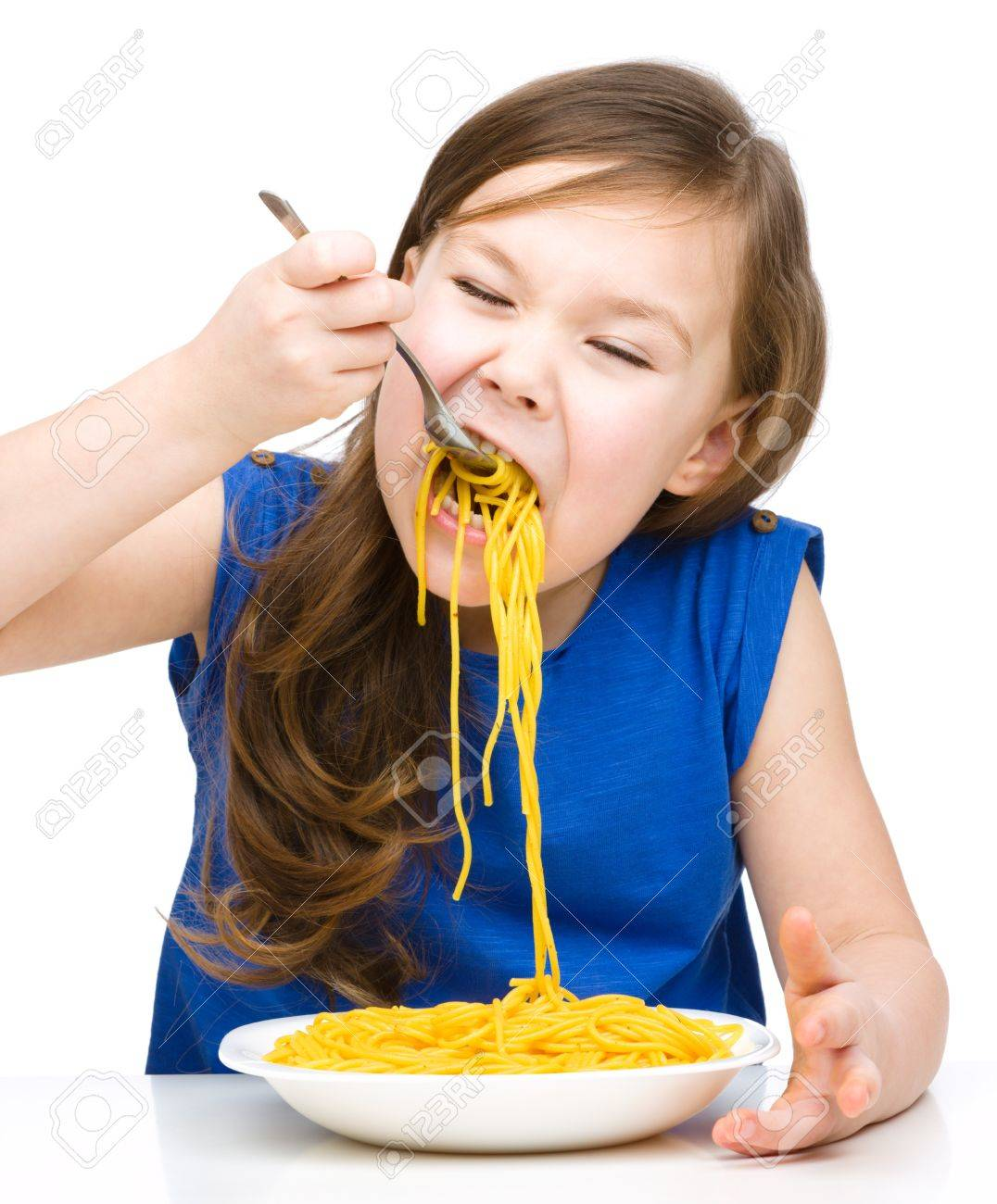 Little girl is eating spaghetti, isolated over white Stock Photo - 18693245