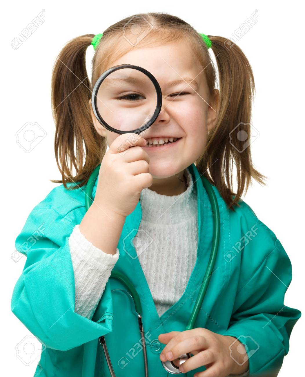 Cute little girl is playing doctor with magnifier, isolated over white Stock Photo - 18730342