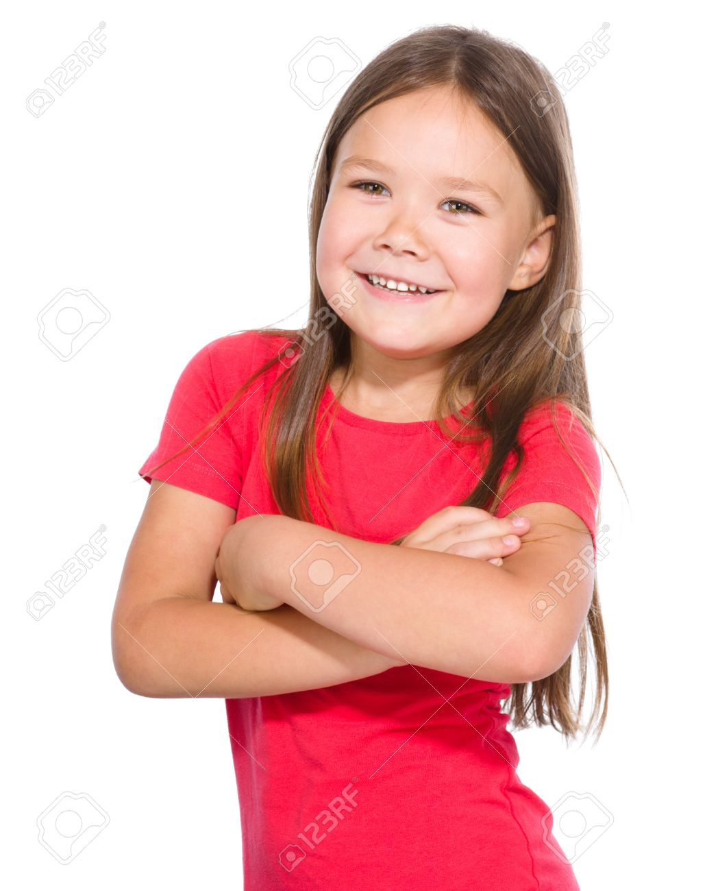 fbde7e549d642 Portrait of a happy little girl in red t-shirt crossing her hands, isolated