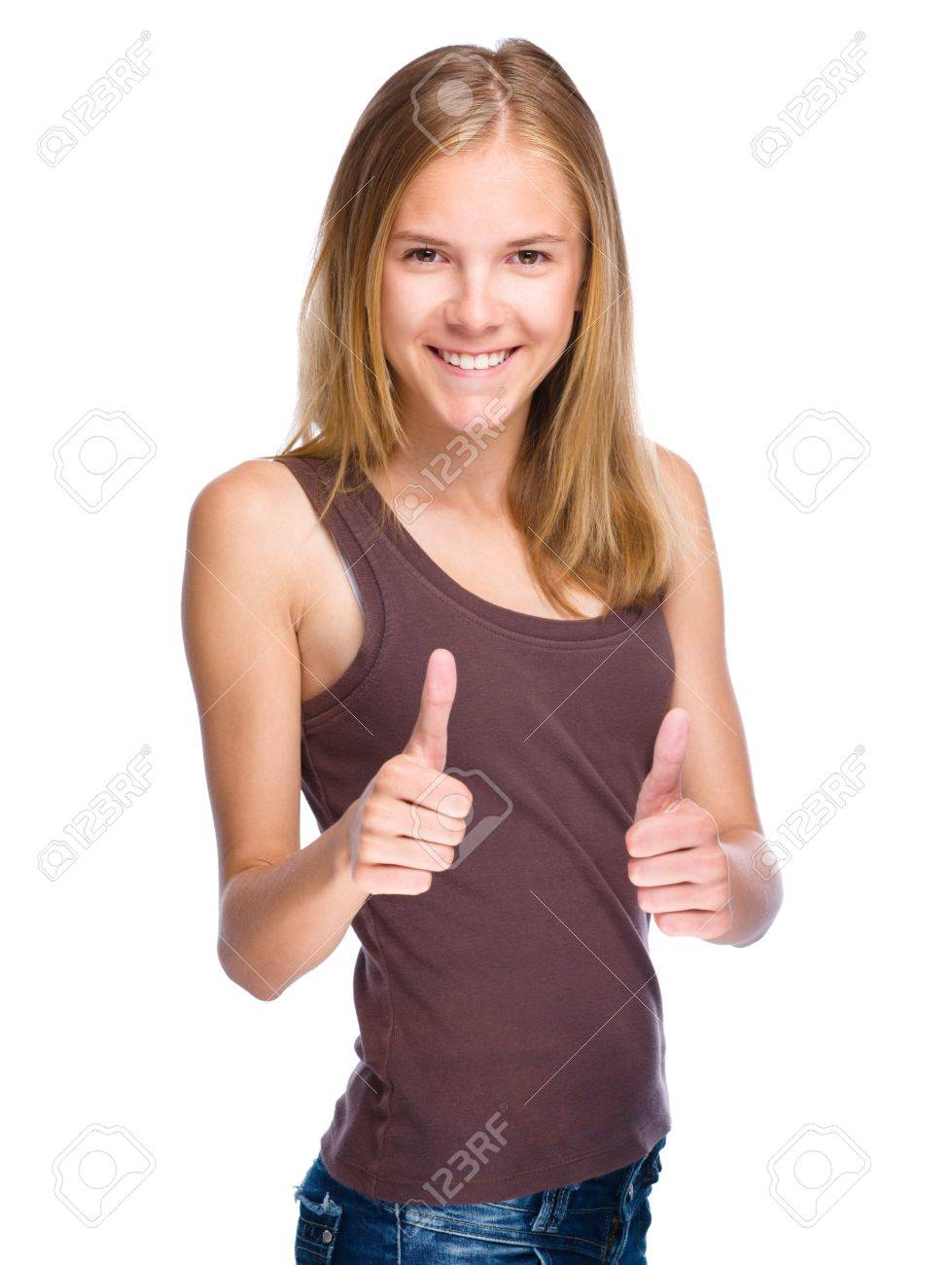 Young girl is showing thumb up gesture using both hands, isolated over white Stock Photo - 21000351