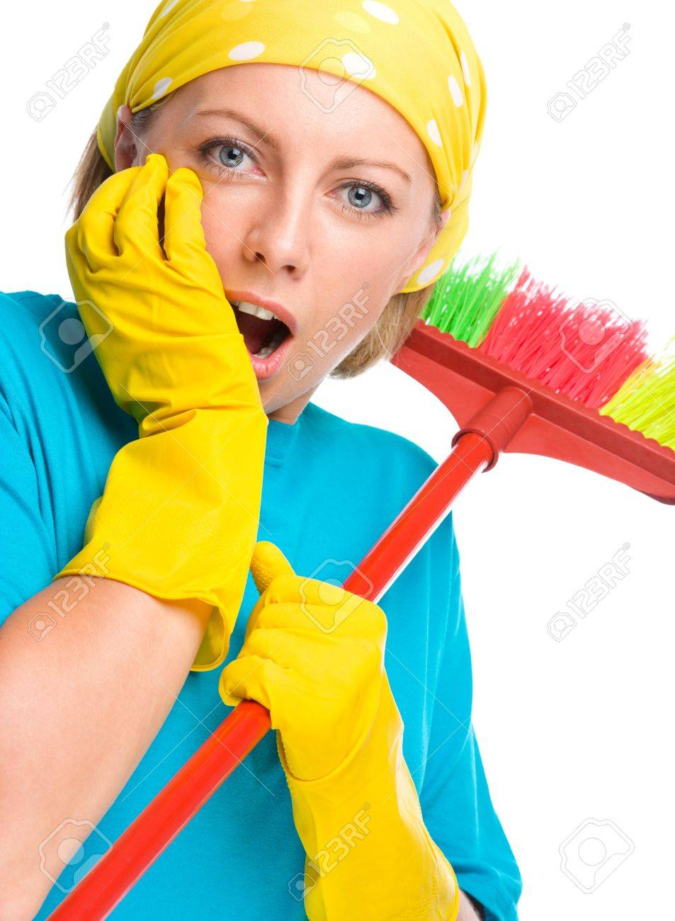Young woman - cleaning maid with broom holding her face in astonishment, isolated over white Stock Photo - 21621835