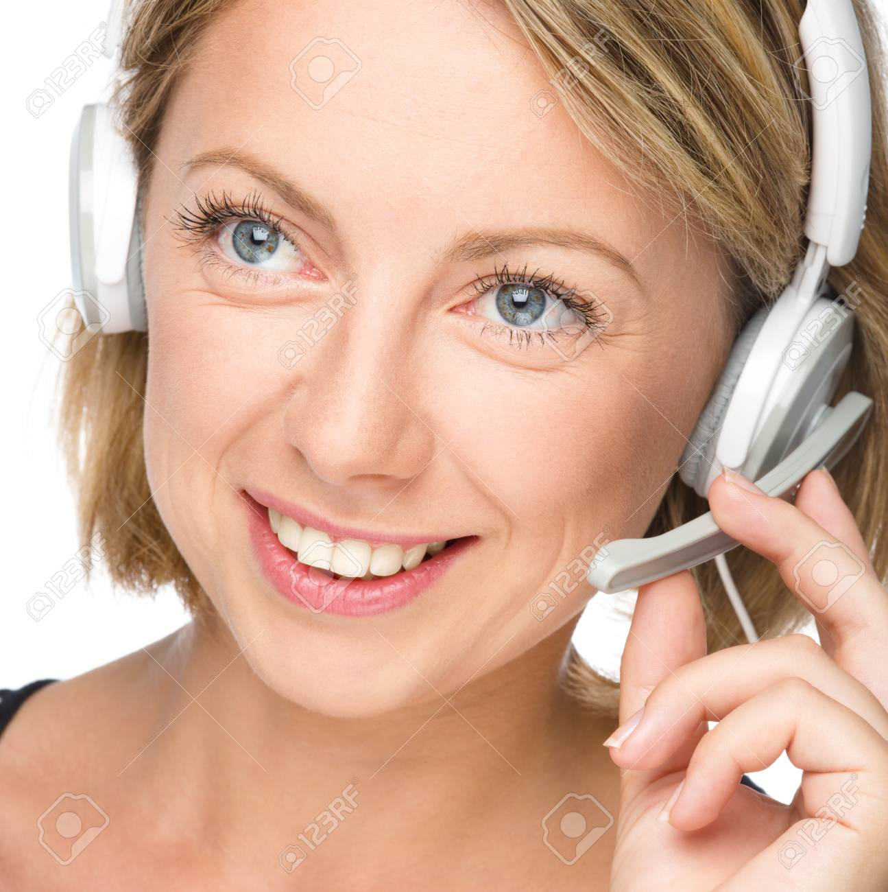 Closeup portrait of lovely young woman talking to customers as a consultant using headset, isolated over white Stock Photo - 22483650