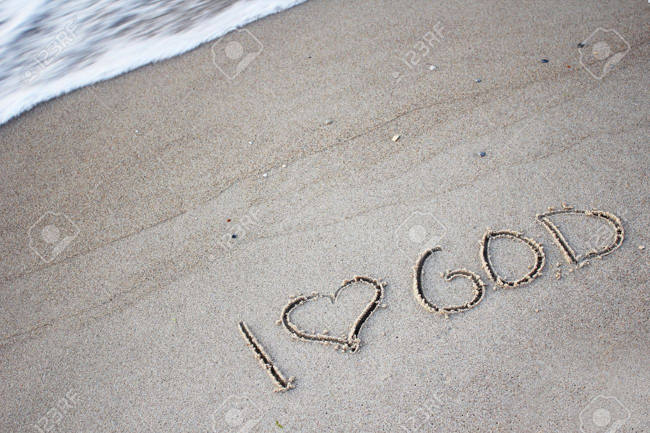 the words  I love God  in the sand Stock Photo - 14036138