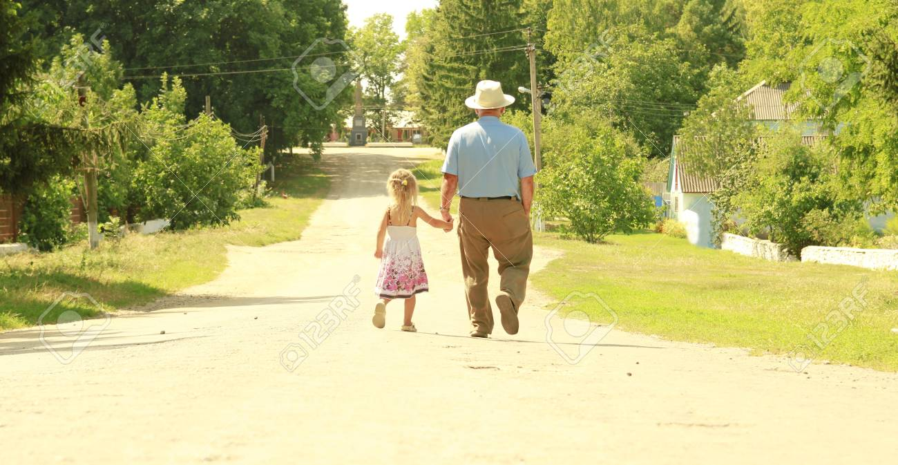 a Grandfather and granddaughter are on the road Stock Photo - 21859266