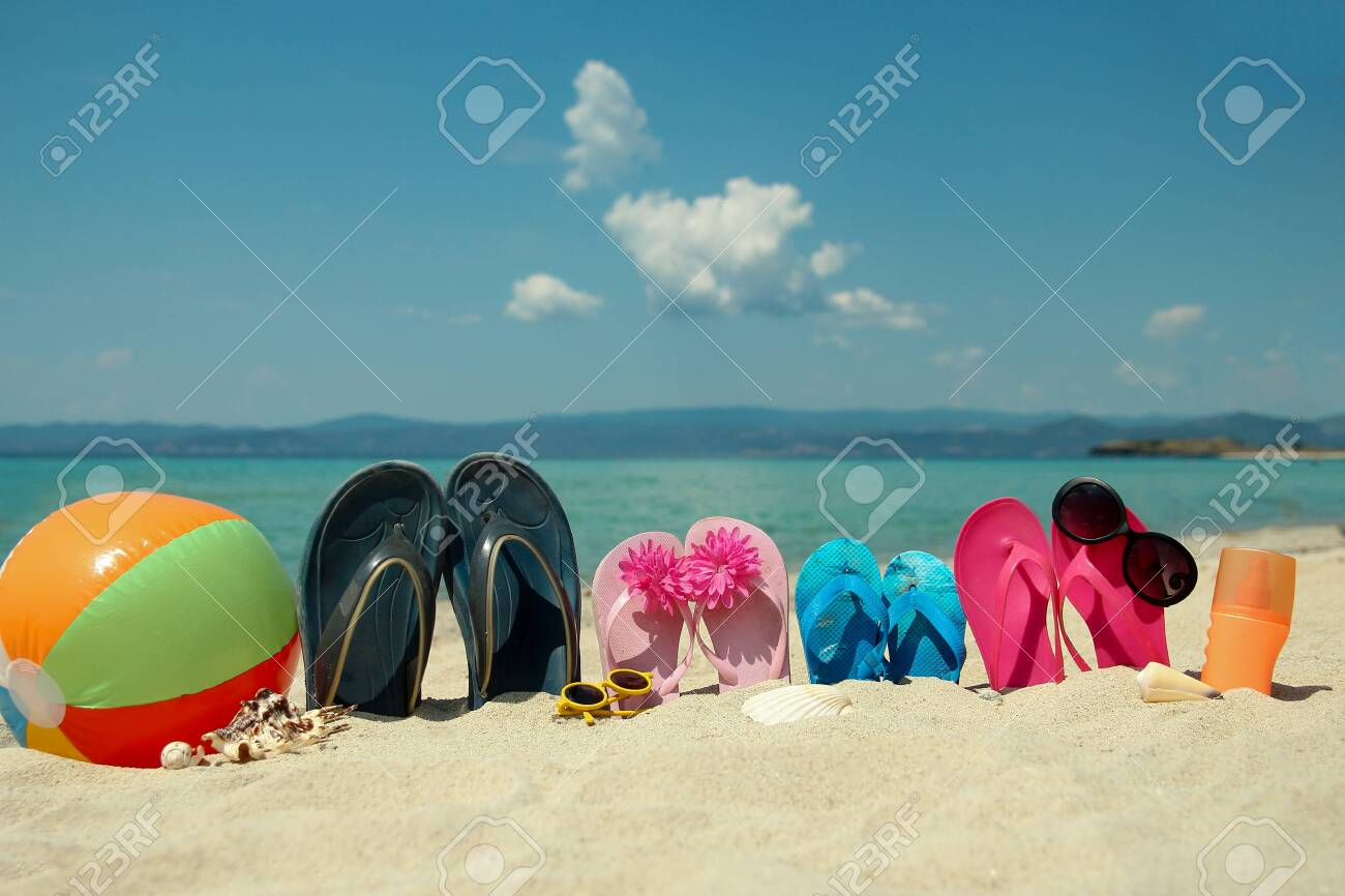 Family slippers on the sand on the beachin summer - 135780185