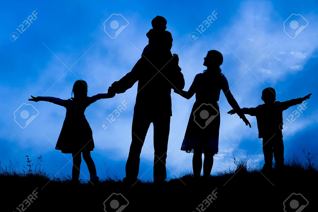 happy family by the sea on nature silhouette background - 168408836