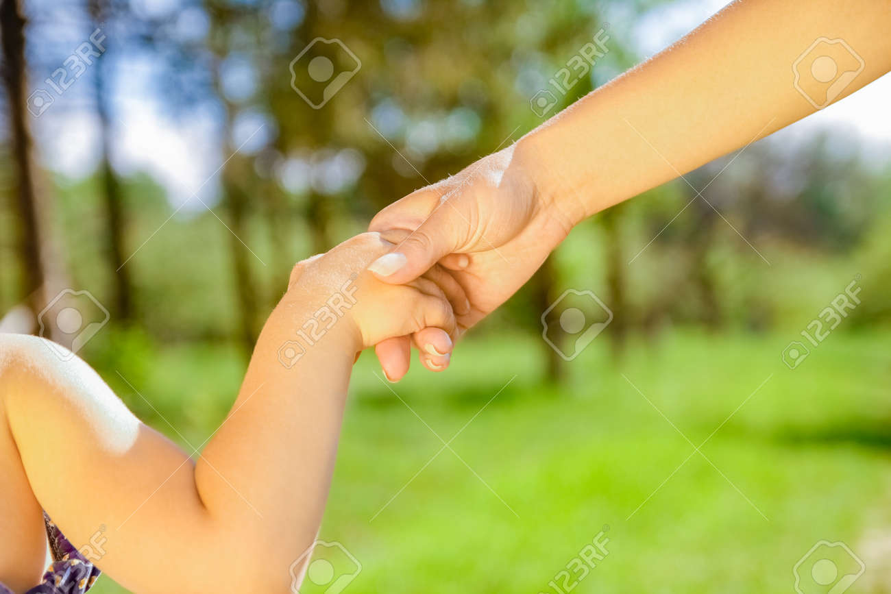hands Happy parents and child outdoors in the park - 169759496