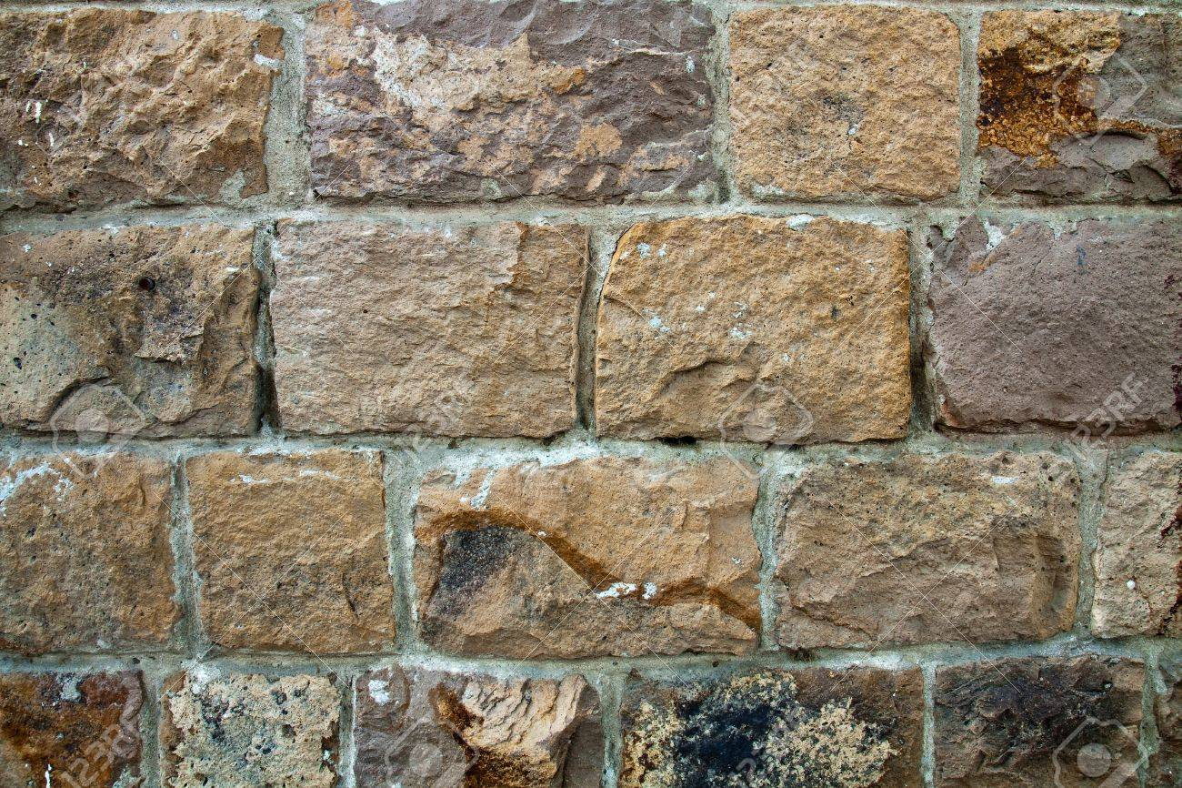 decorative exterior wall covering resembling a stone wall stock photo