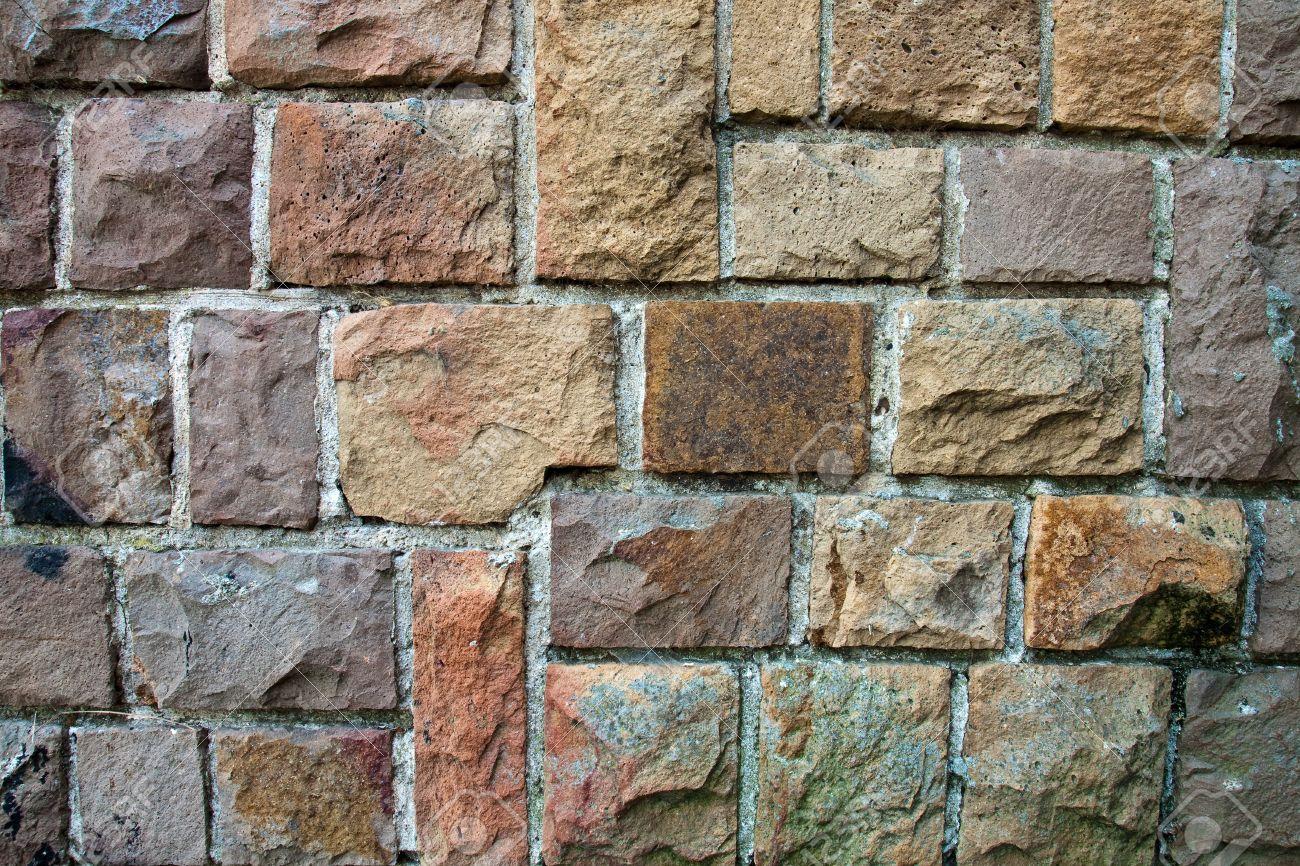 decorativo de pared cubierta exterior se asemeja a un muro de piedra foto de archivo