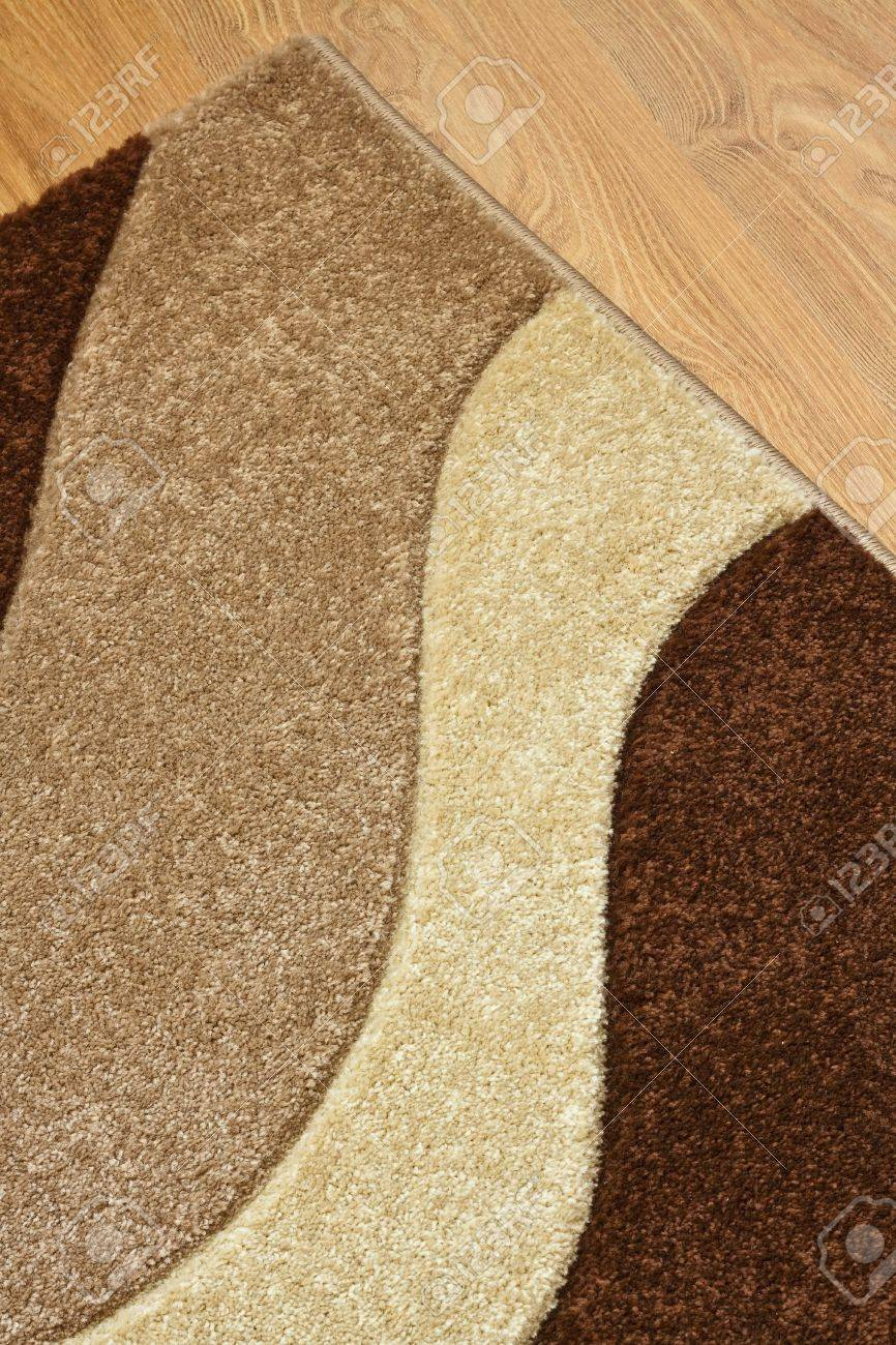 Detail of carpet in brown, beige and white colors on laminate Stock Photo - 14476016