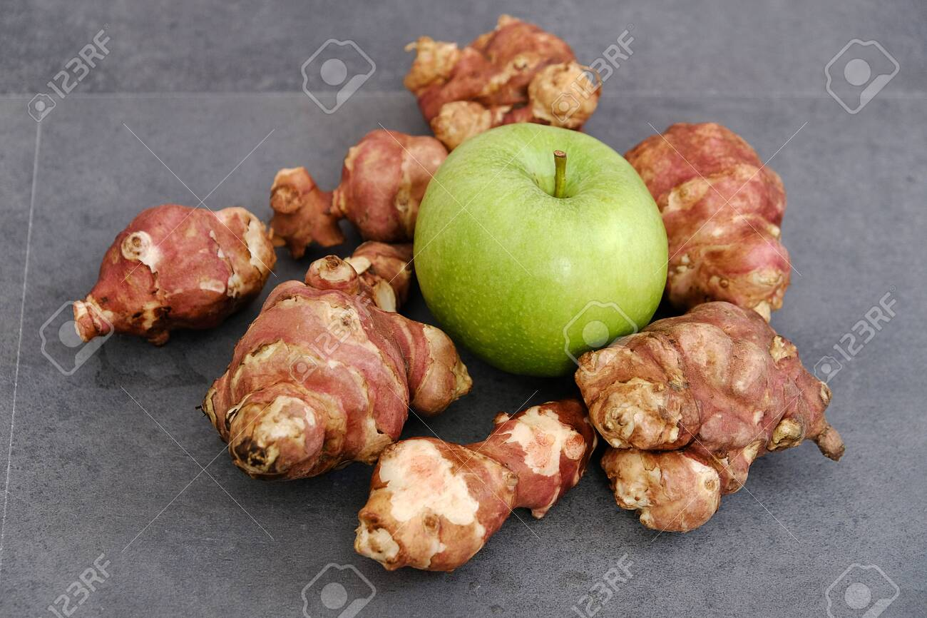 Jerusalem Artichoke And Green Apple On Black Ground Stock Photo Picture And Royalty Free Image Image 145192286