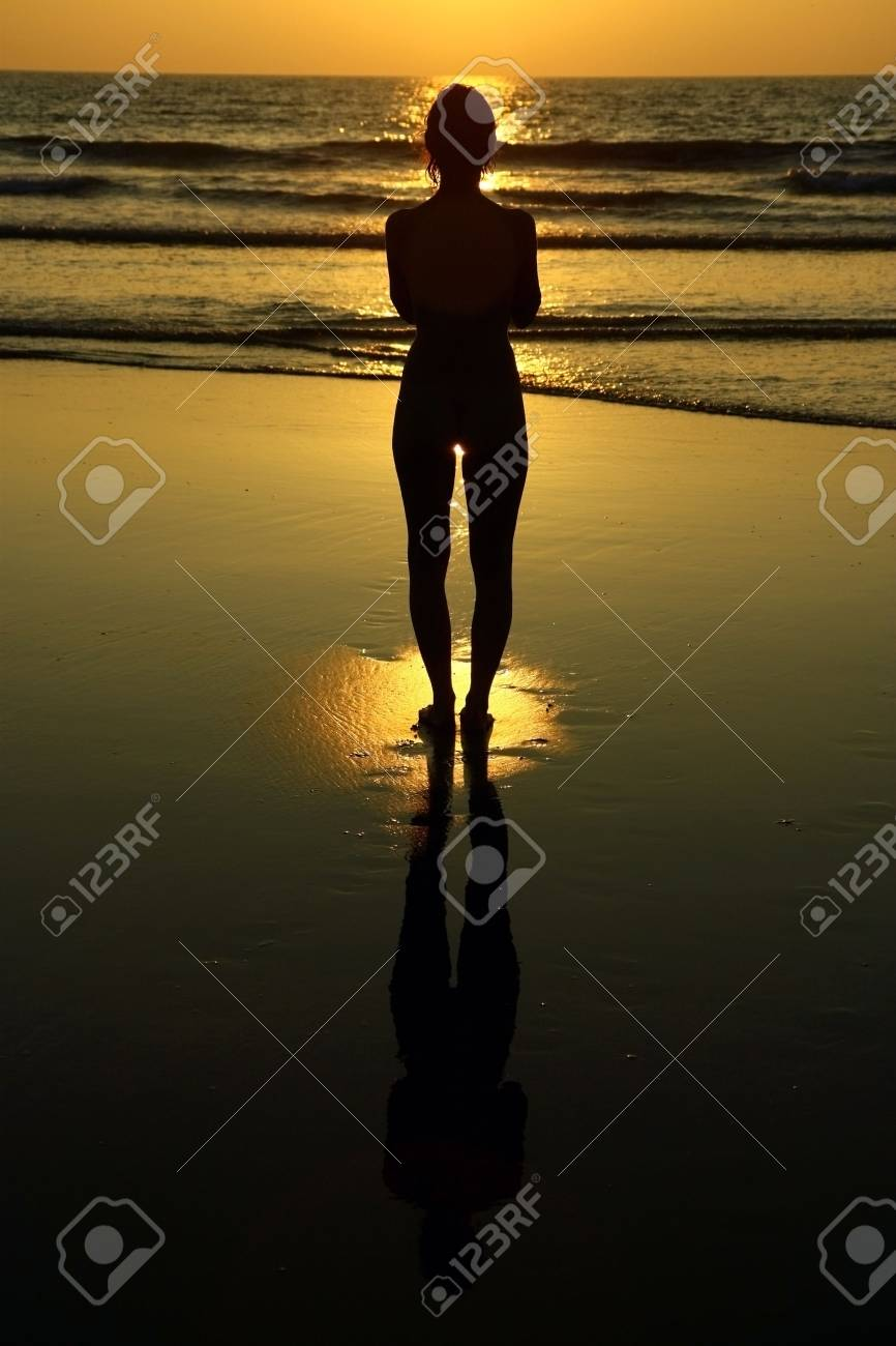 girl practicing yoga during the sunset on the beach Stock Photo - 6683512