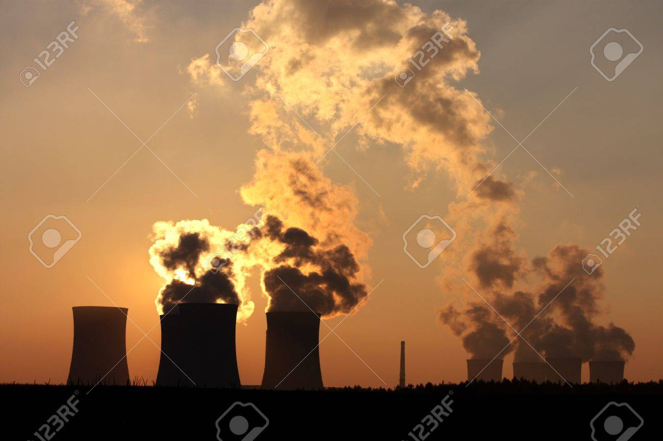 chimney and cooling towers of power plant during sunset Stock Photo - 8152111