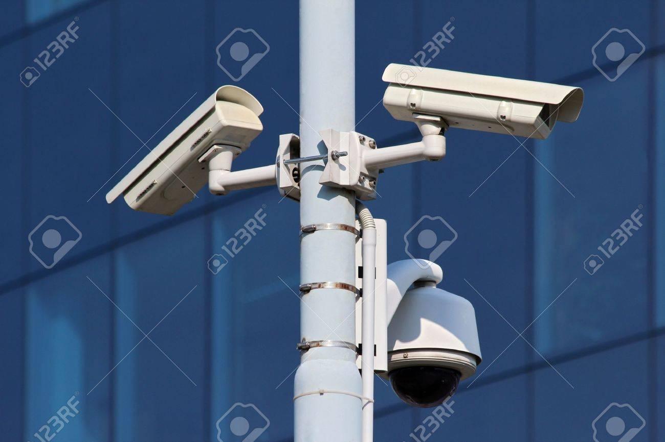 three cctv security cameras on street pylon Stock Photo - 11994944