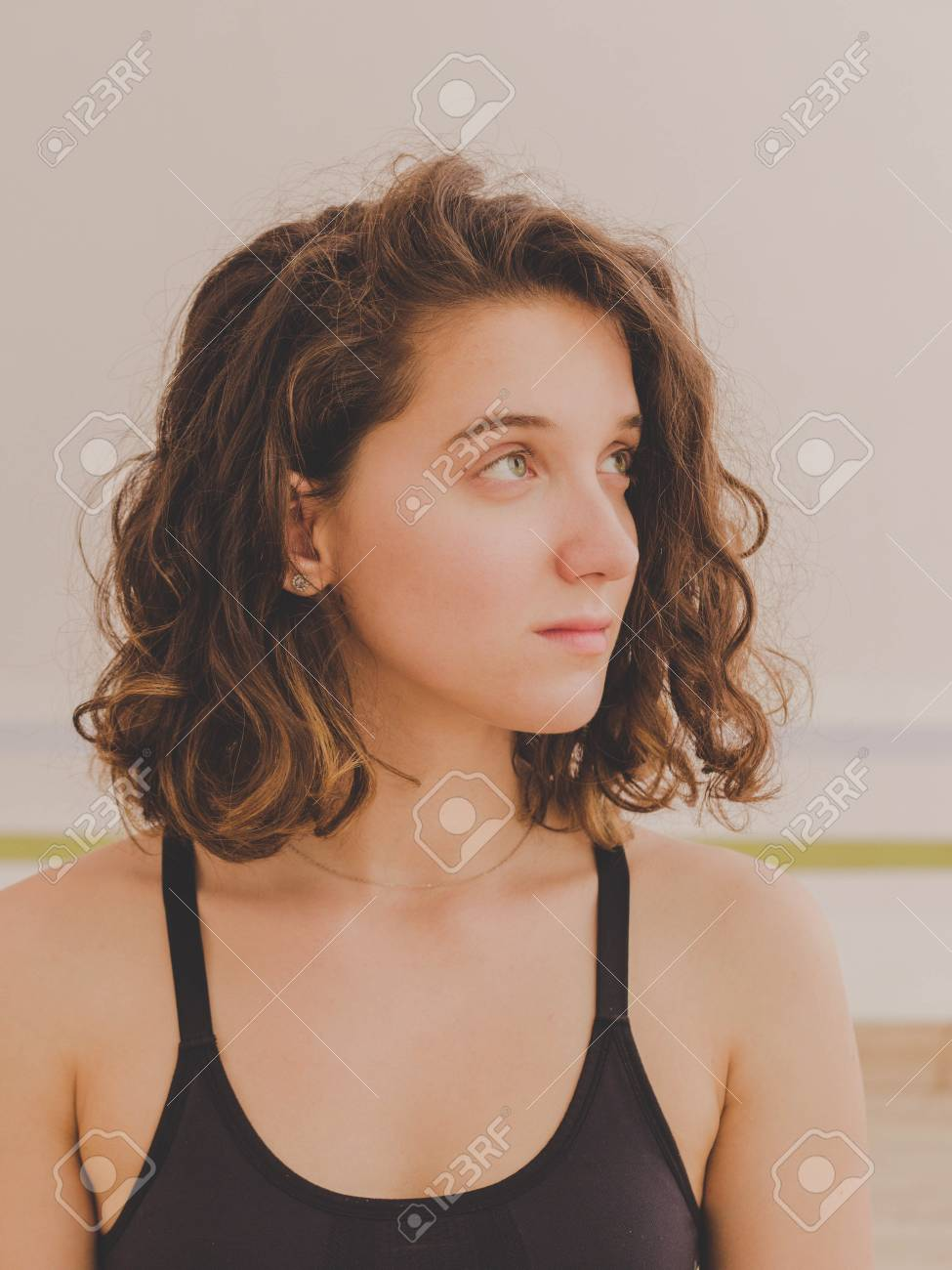 Portrait Of Young Pretty Yoga Girl With Short Curly Hair In