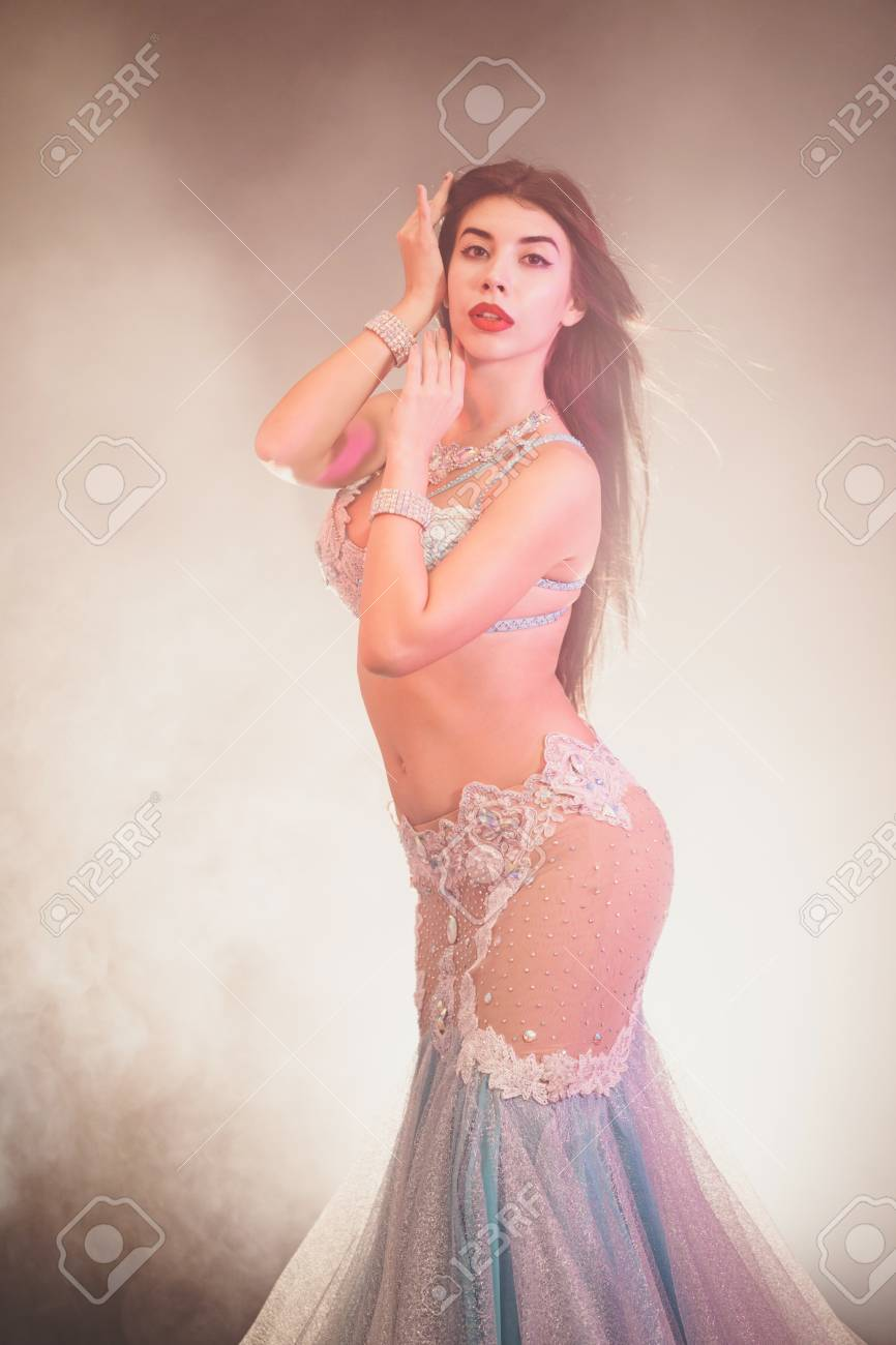 Costume posing nude