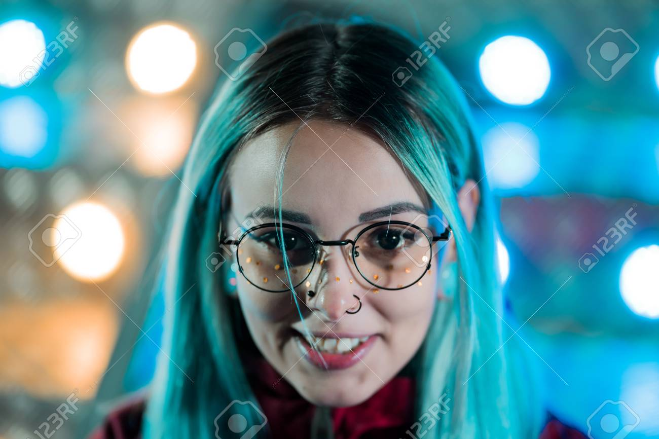 Hipster Girl With Blue Dyed Hair And Golden Sequins As Freckles