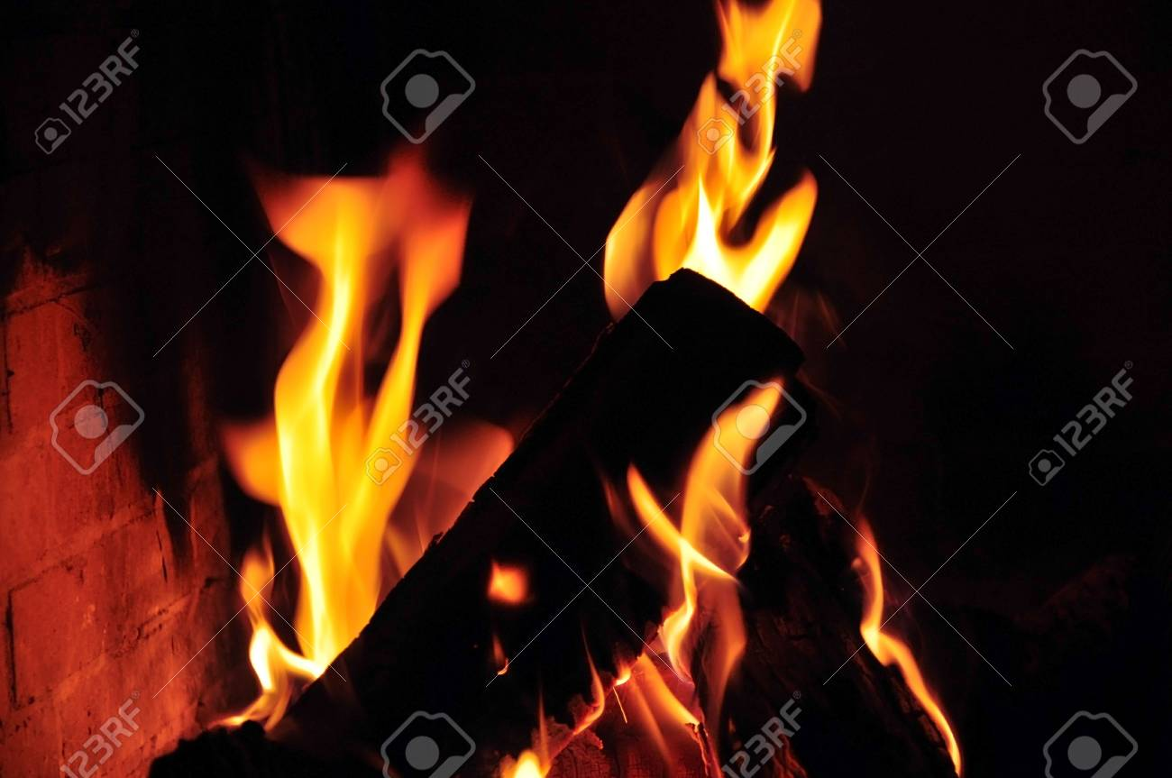 A fire is burning in the open fireplace Stock Photo - 6382158
