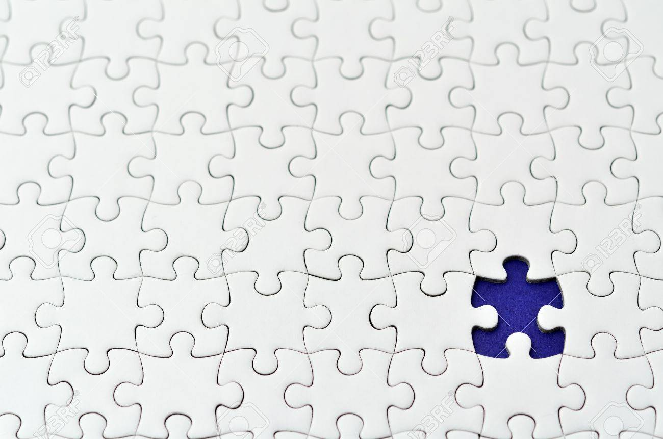 Plain White Jigsaw Puzzle On Navy Background Stock Photo