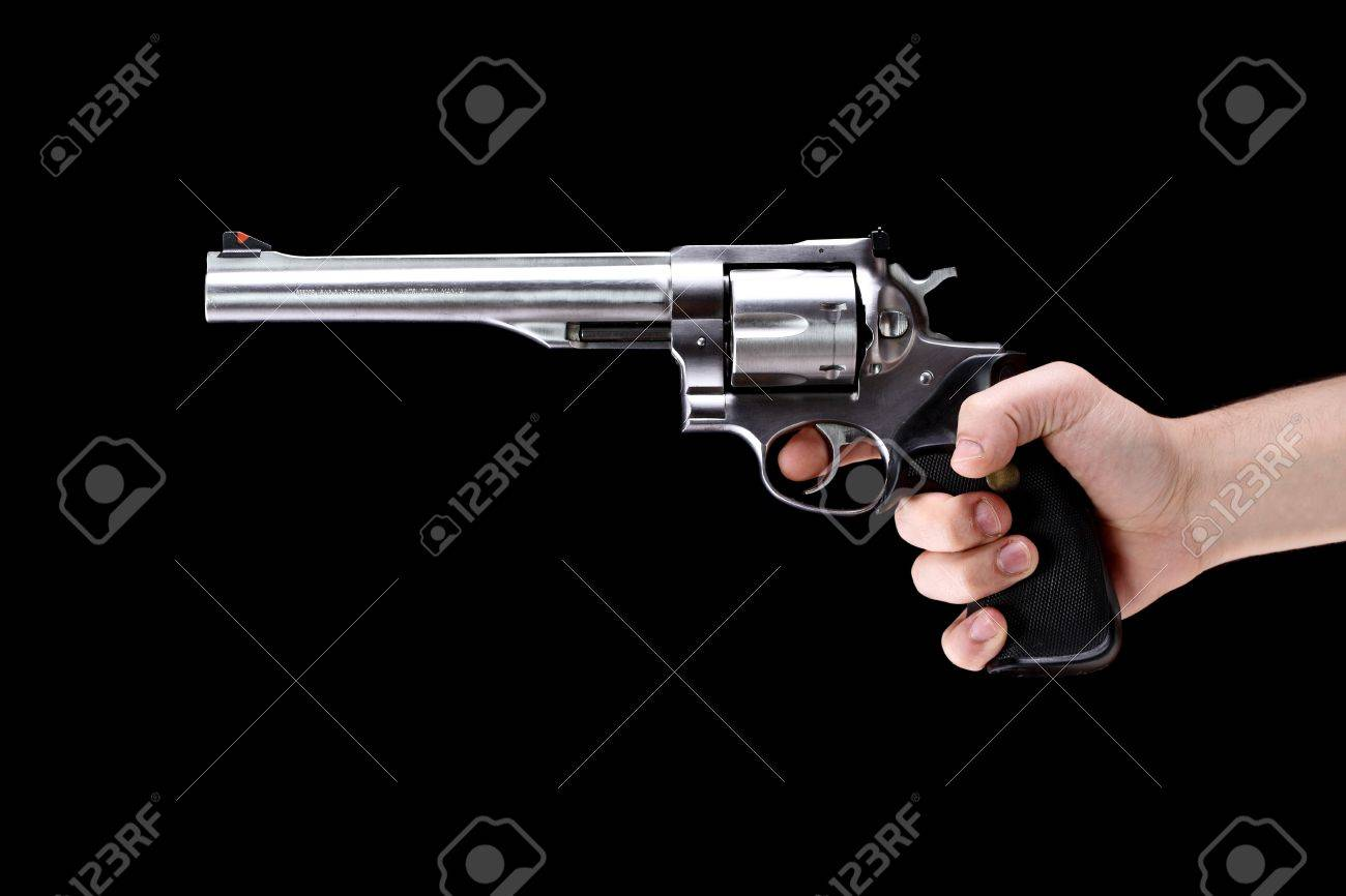 hand holding a revolver, aiming straight, against black background Stock Photo - 9329935