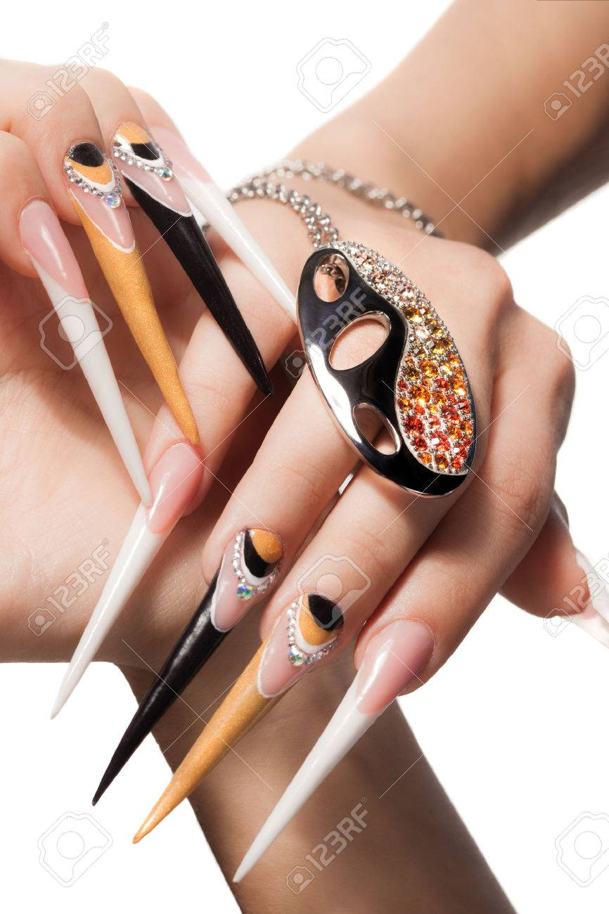extremely long nails with nail-art and crystal jewellery, Stock Photo -  27780756 - Extremely Long Nails With Nail-art And Crystal Jewellery, Stock