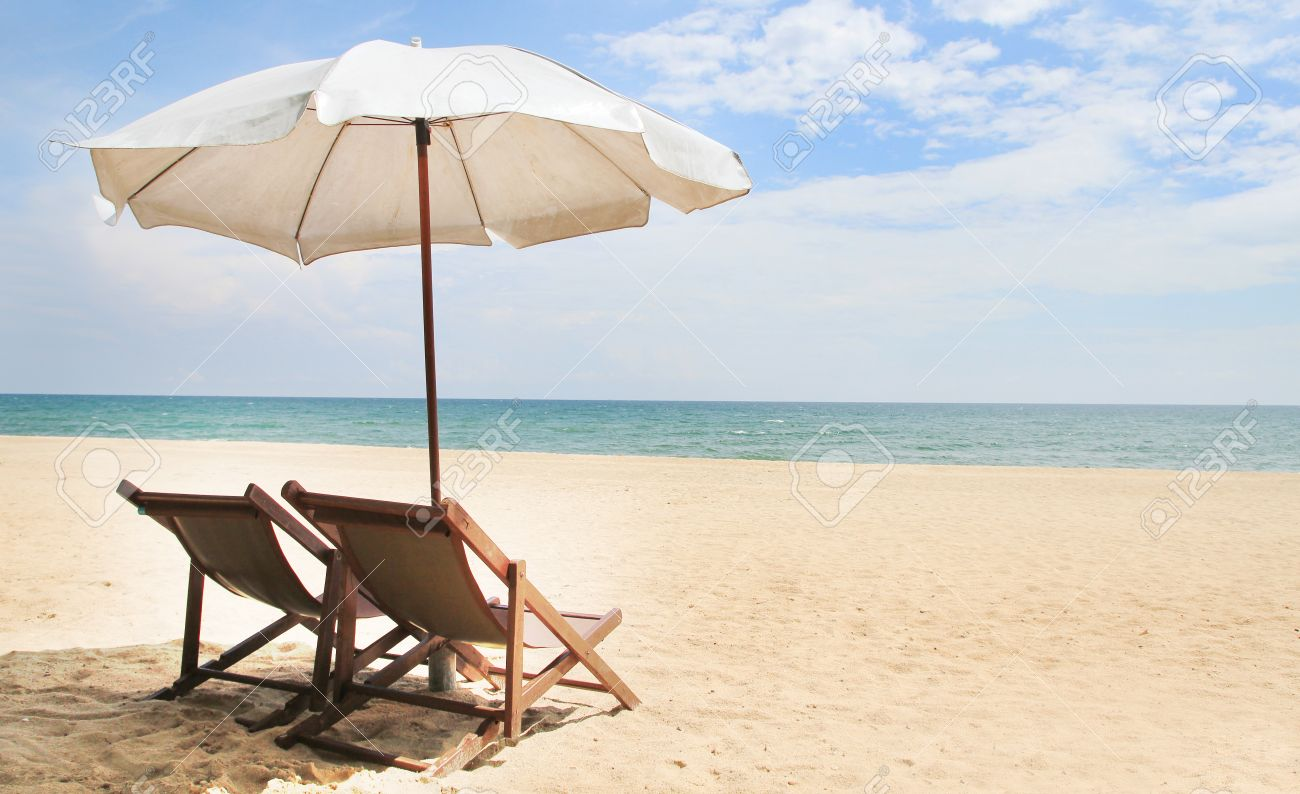 Stock Photo   Two Chairs Under Umbrella On Beautiful Tropical Beach In  Thailand