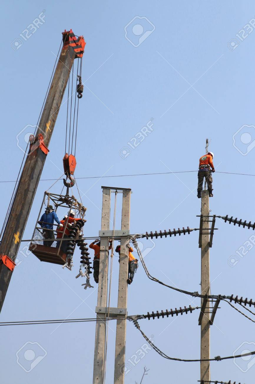 Electrician Working At Height By Connect A High Voltage Wire ...