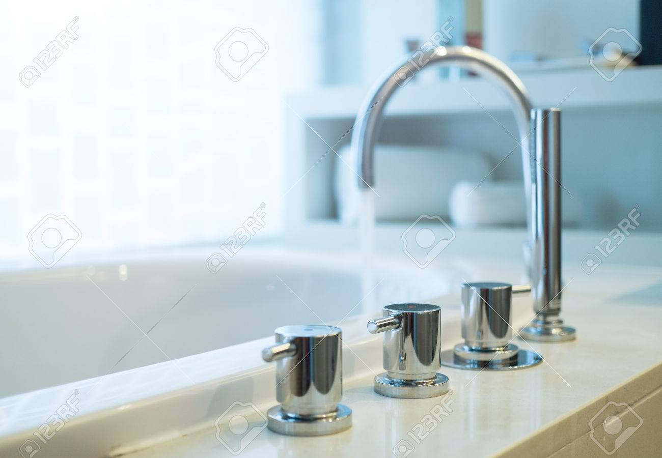Bathtub Faucet With Running Water,shallow Focus. Stock Photo ...