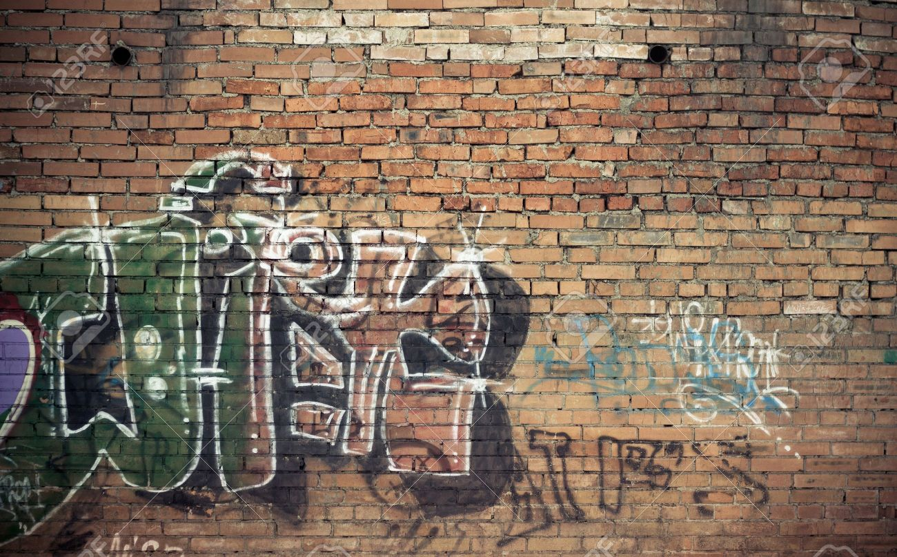 Old Brick Wall With Graffiti Stock Photo
