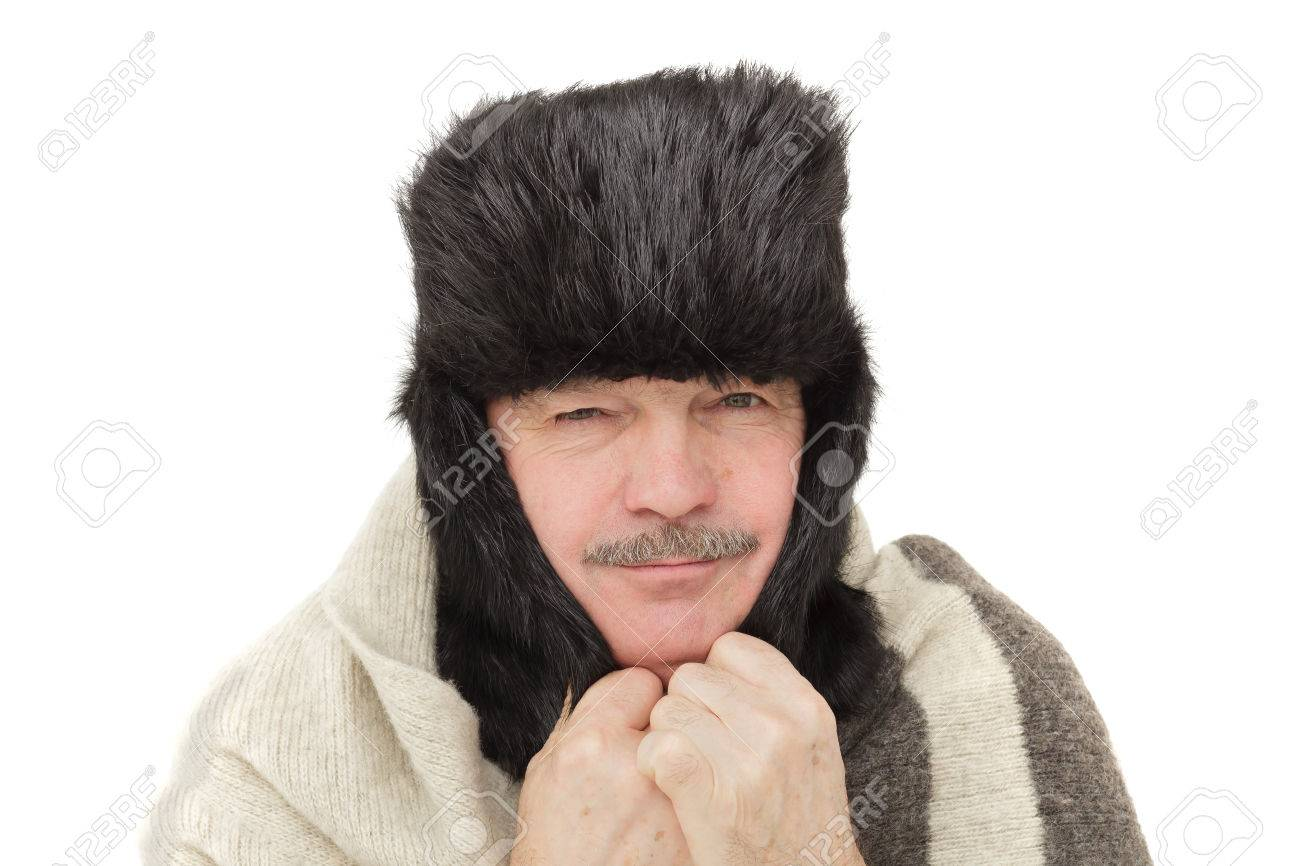 9fd0482ce7a8d elderly man in fur hat with ear flaps covers his ears from the cold Stock  Photo