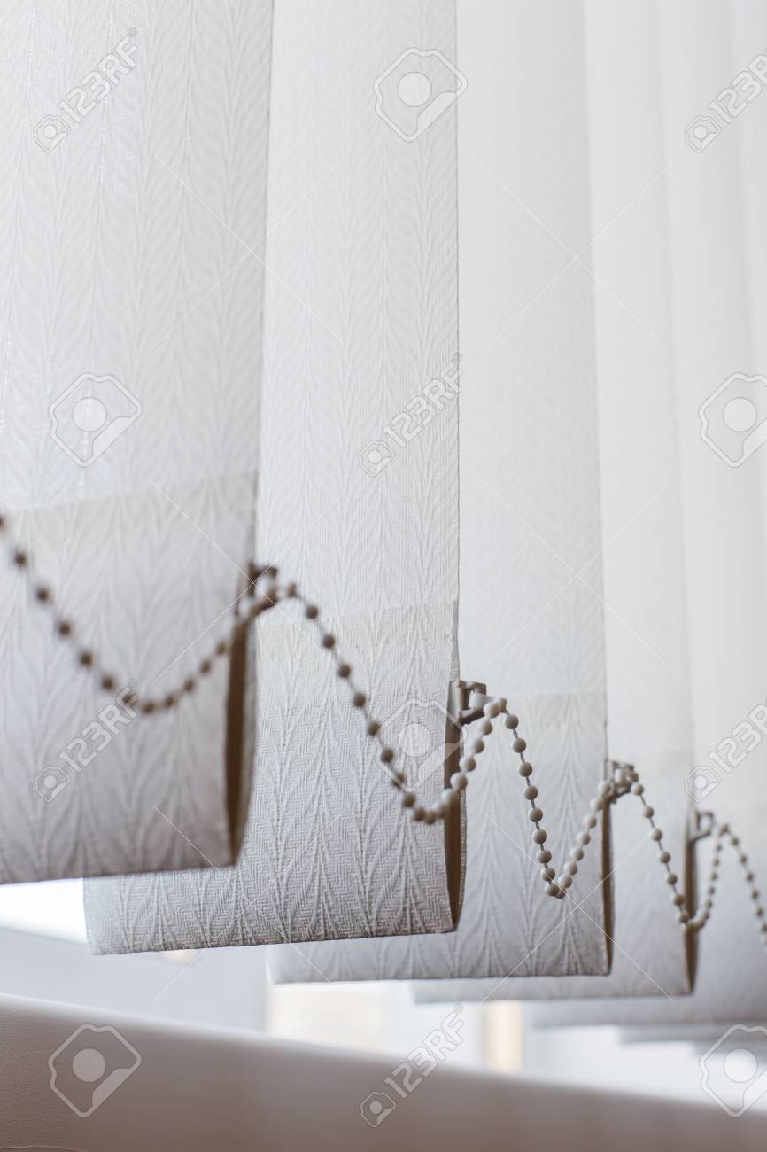 white vertical blinds long stock photo white vertical blinds with chain in the office vertical blinds with chain in the office
