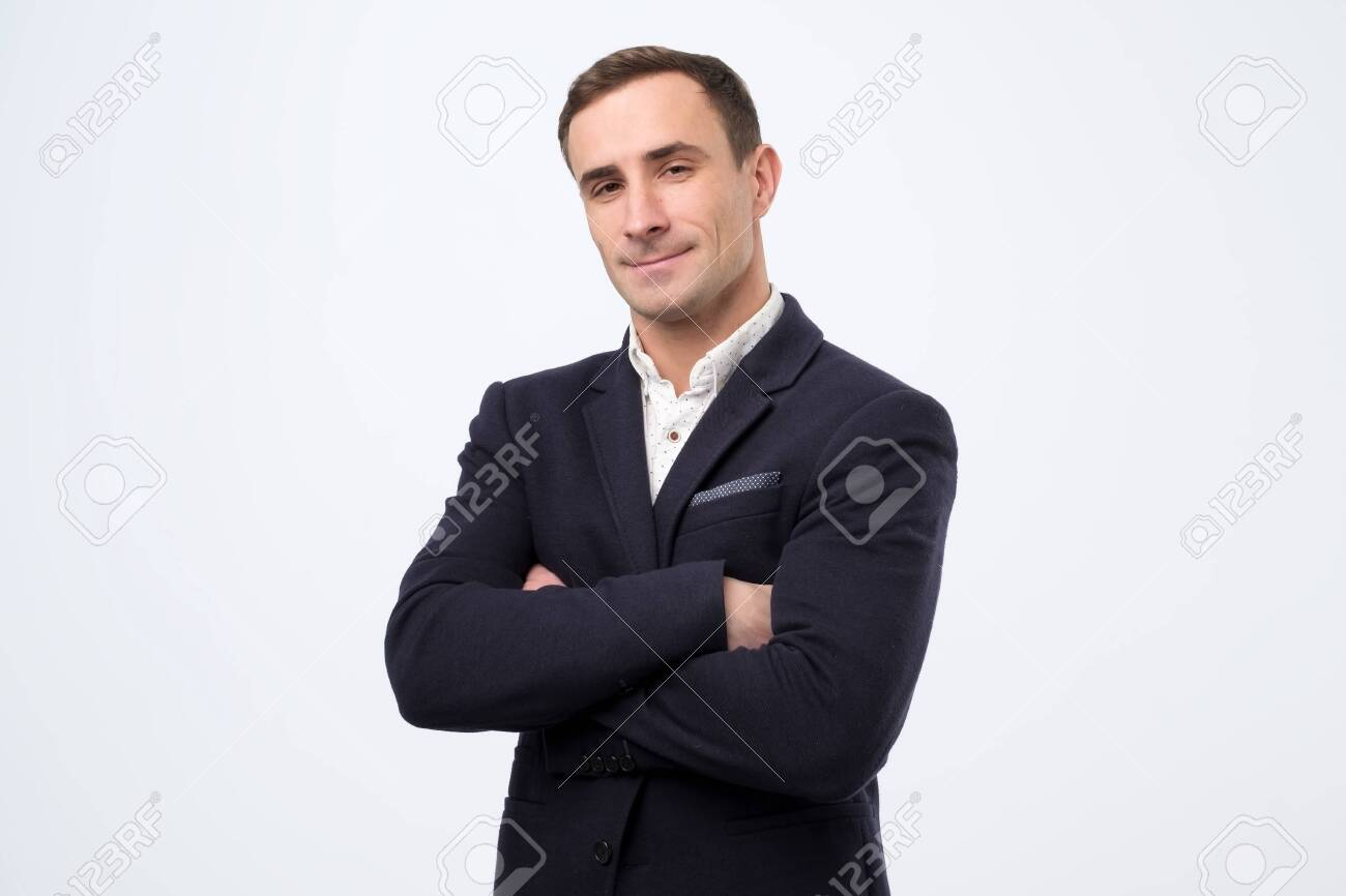 Confident italian mature man with folded hands looking at camera. - 138815198