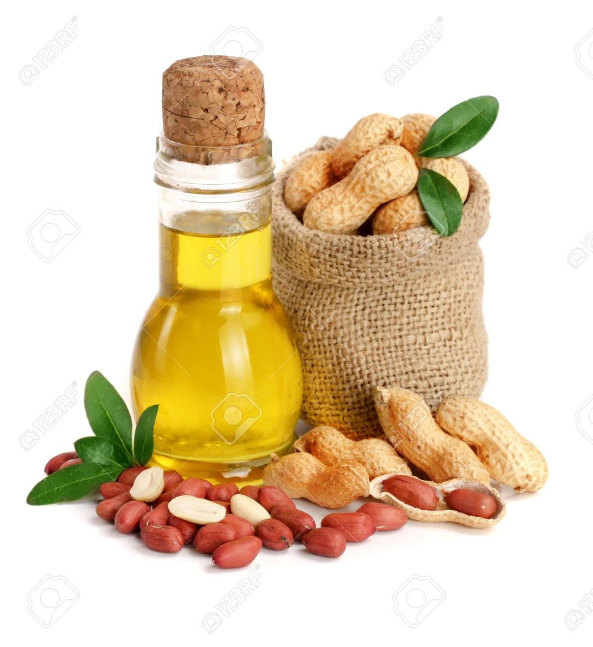 peanut oil in a glass bottle with peanuts in bag. - 88303182