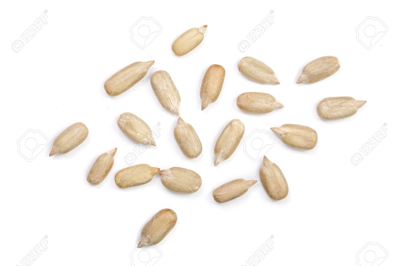 Peeled Sunflower seeds isolated on white background. Top view . - 90882533