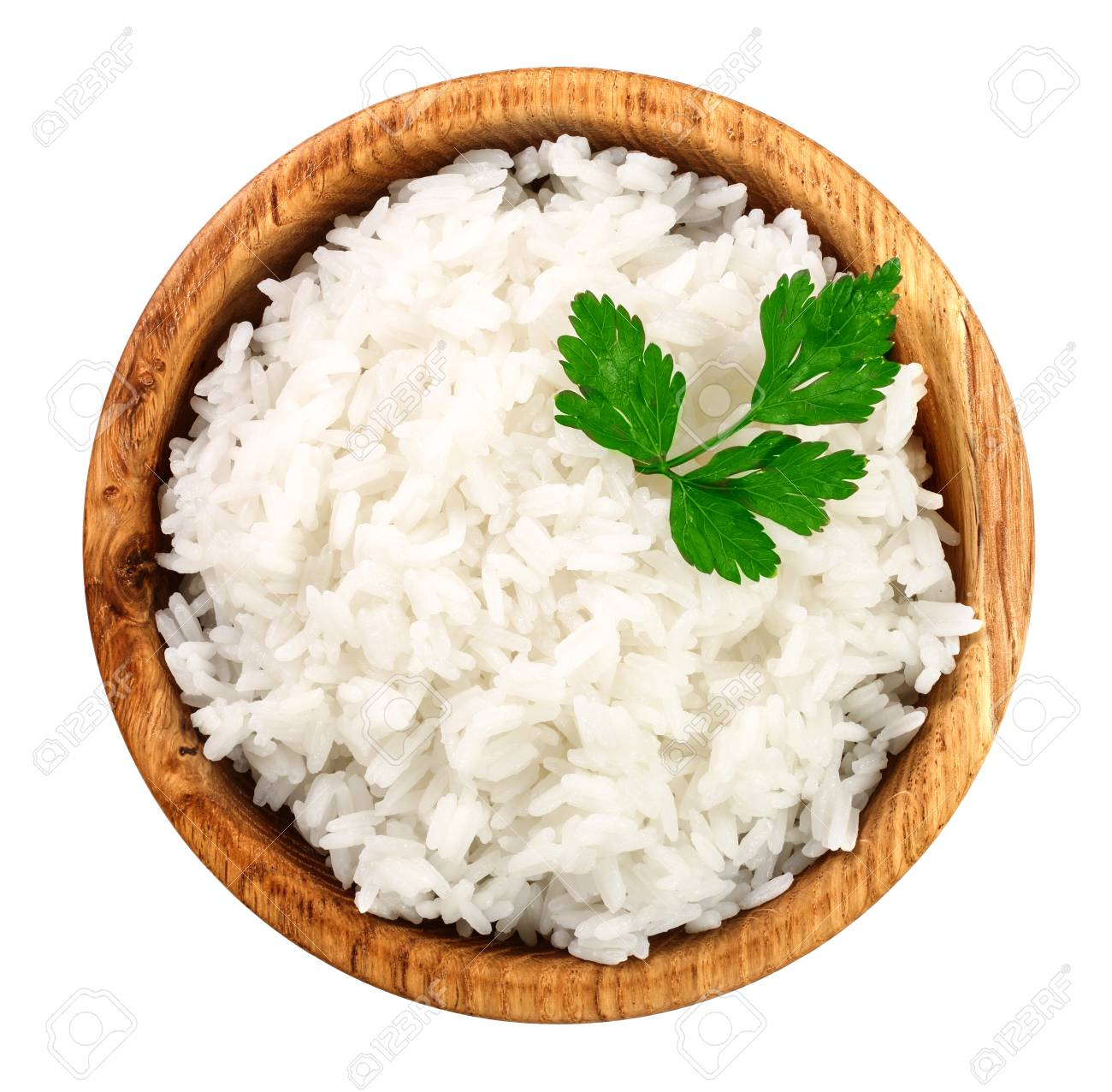 rice in a wooden bowl isolated on white background. Top view. Flat lay. - 105856567