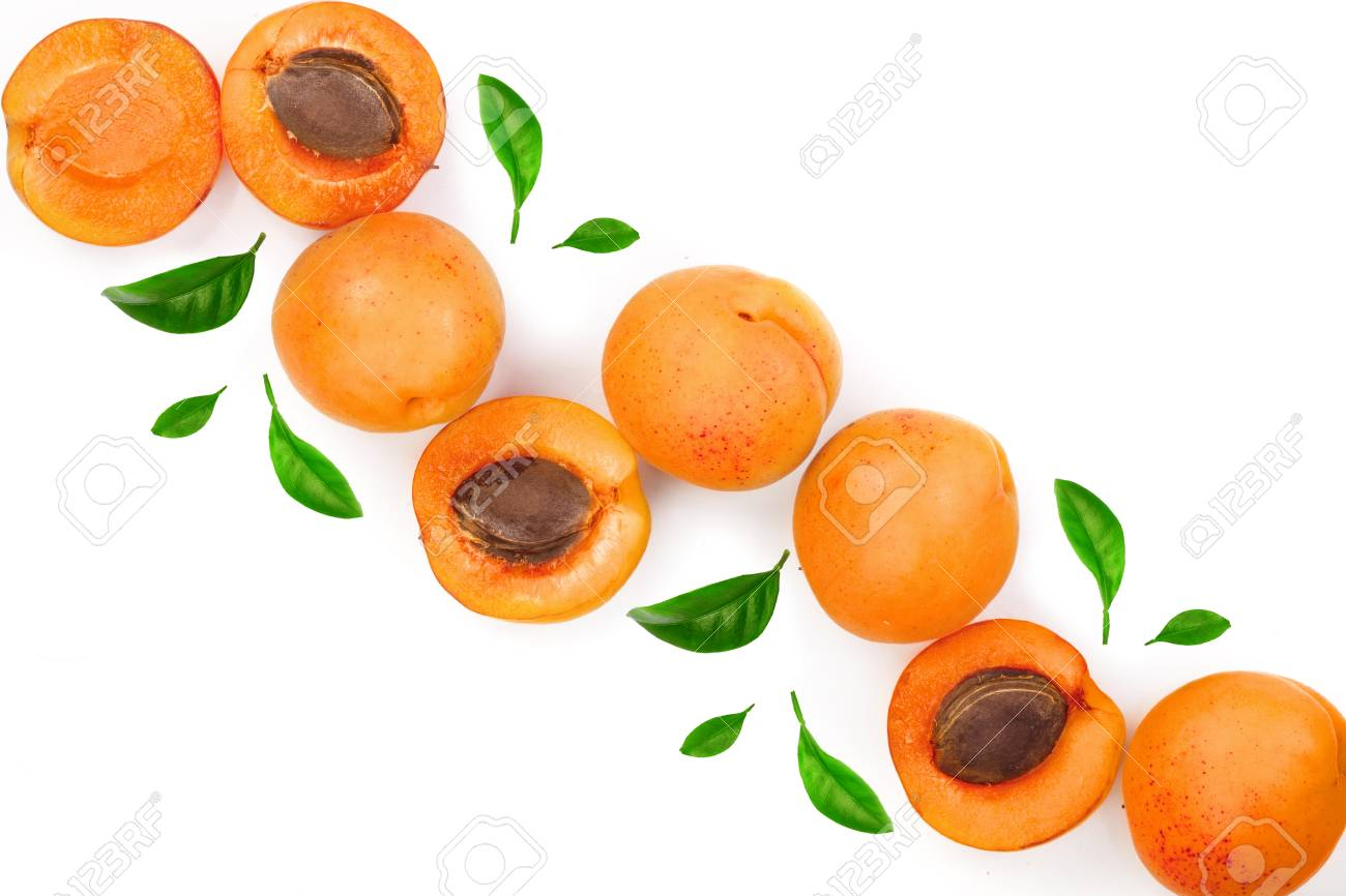 Apricot fruits with leaves isolated on white background with copy space for your text. Top view. Flat lay pattern. - 108121016