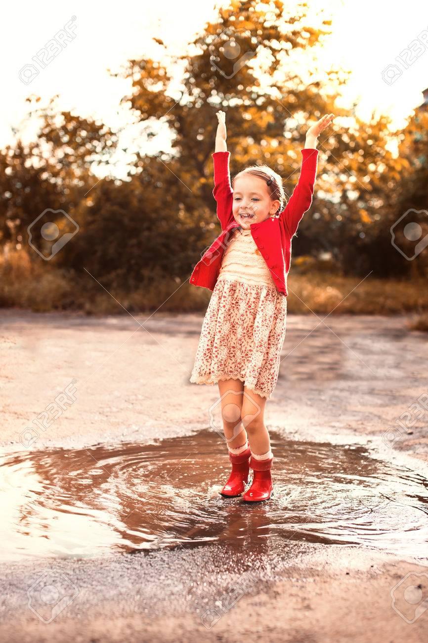 Cute Little Girl Wearing Red Rain Boots