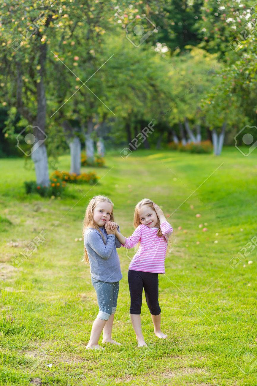 Two Cute Girls Playing In The Park A Beautiful Sunny Day Girls