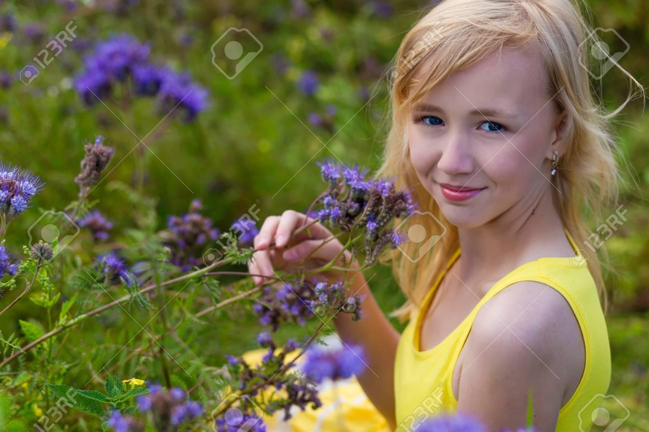 Beautiful young girl in a yellow dress in a blooming summer field beautiful young girl in a yellow dress in a blooming summer field girl in purple mightylinksfo
