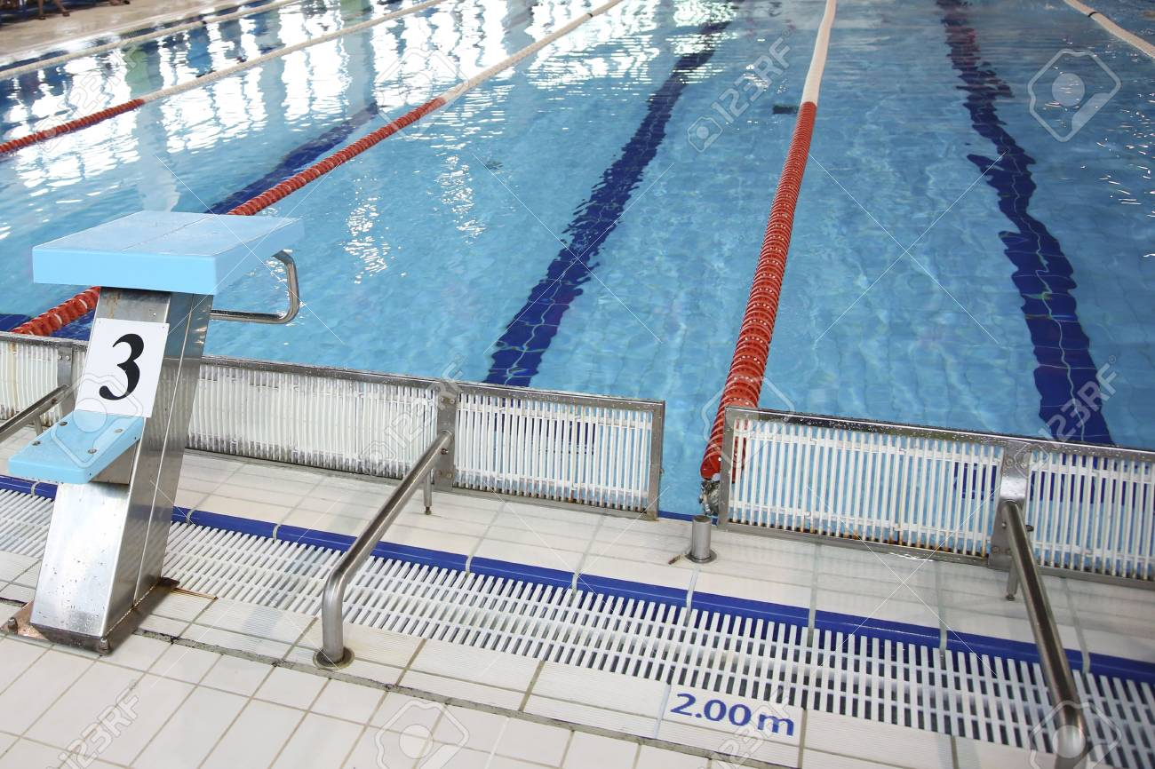 Closeup of the row of lanes in the swimming pool. Diving board