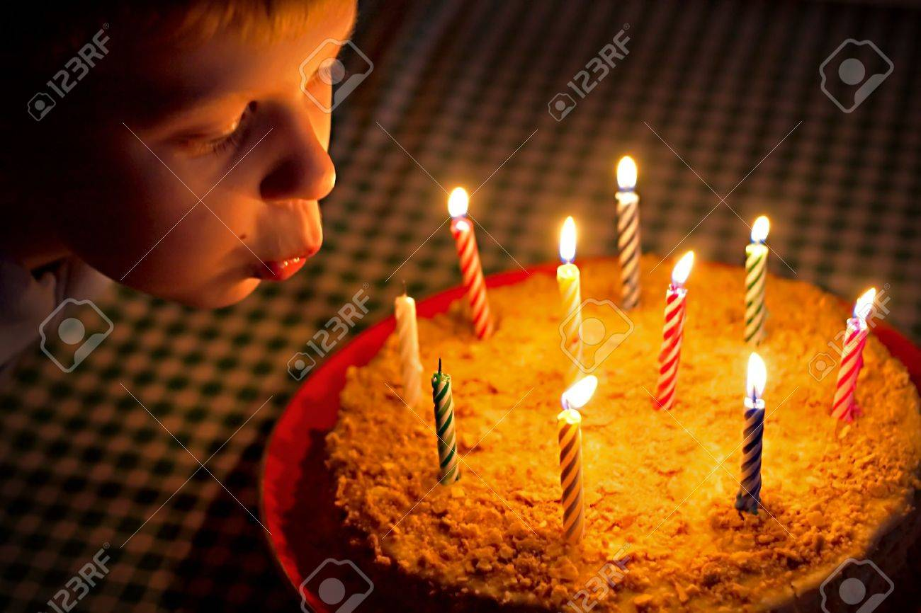 boy blow candles on cake Stock Photo - 5925407