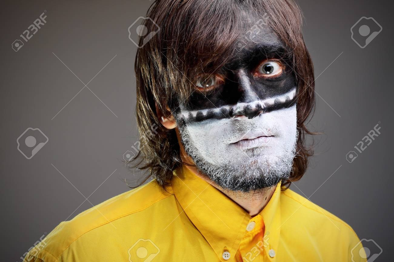 Portrait of a painted young man in studio Stock Photo - 9153140