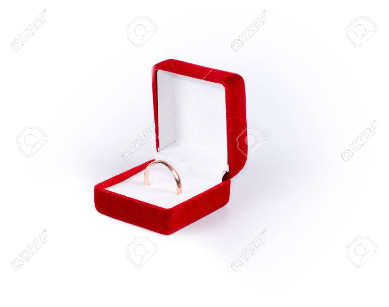 Simple gold band or wedding ring displayed in an open red square jewelery box isolated on white Stock Photo - 17856537