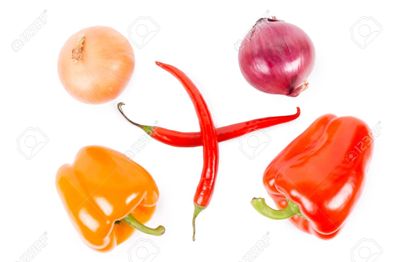 Overhead view of an arrangement of farm fresh brown and red onions, orange and red sweet bell peppers and two crossed red hot chilli peppers isolated on white Stock Photo - 18523636