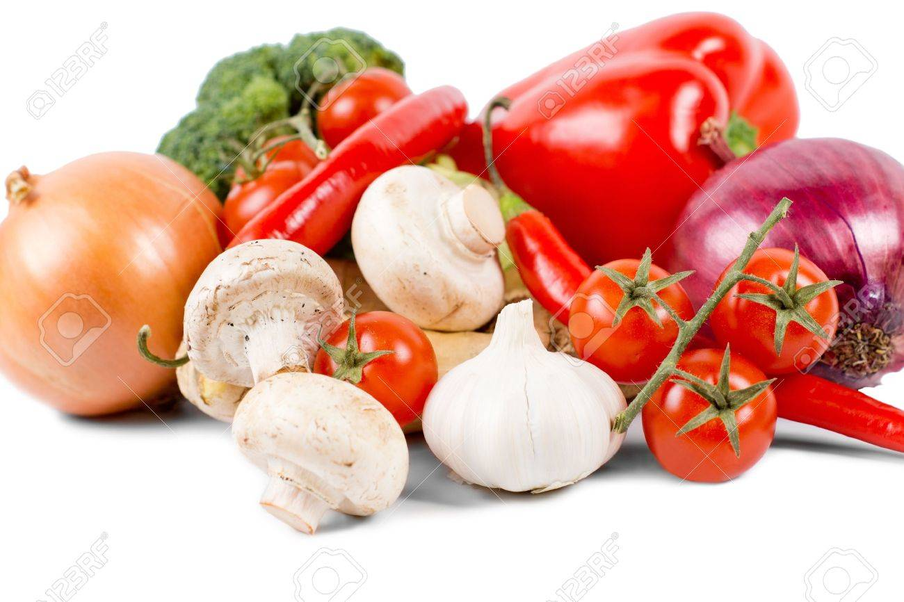 Organic vegetables like onion, mushrooms, broccoli, tomatoes on vine, red pepper and red chili pepper, on white background Stock Photo - 18523741