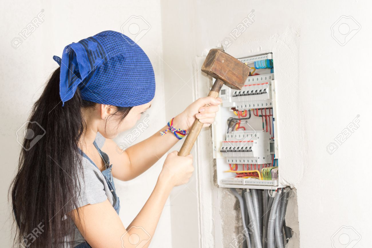 [XOTG_4463]  Woman Taking Aim At An Electrical Fuse Box With A Large Wooden.. Stock  Photo, Picture And Royalty Free Image. Image 20105572. | Large Fuse Box |  | 123RF.com