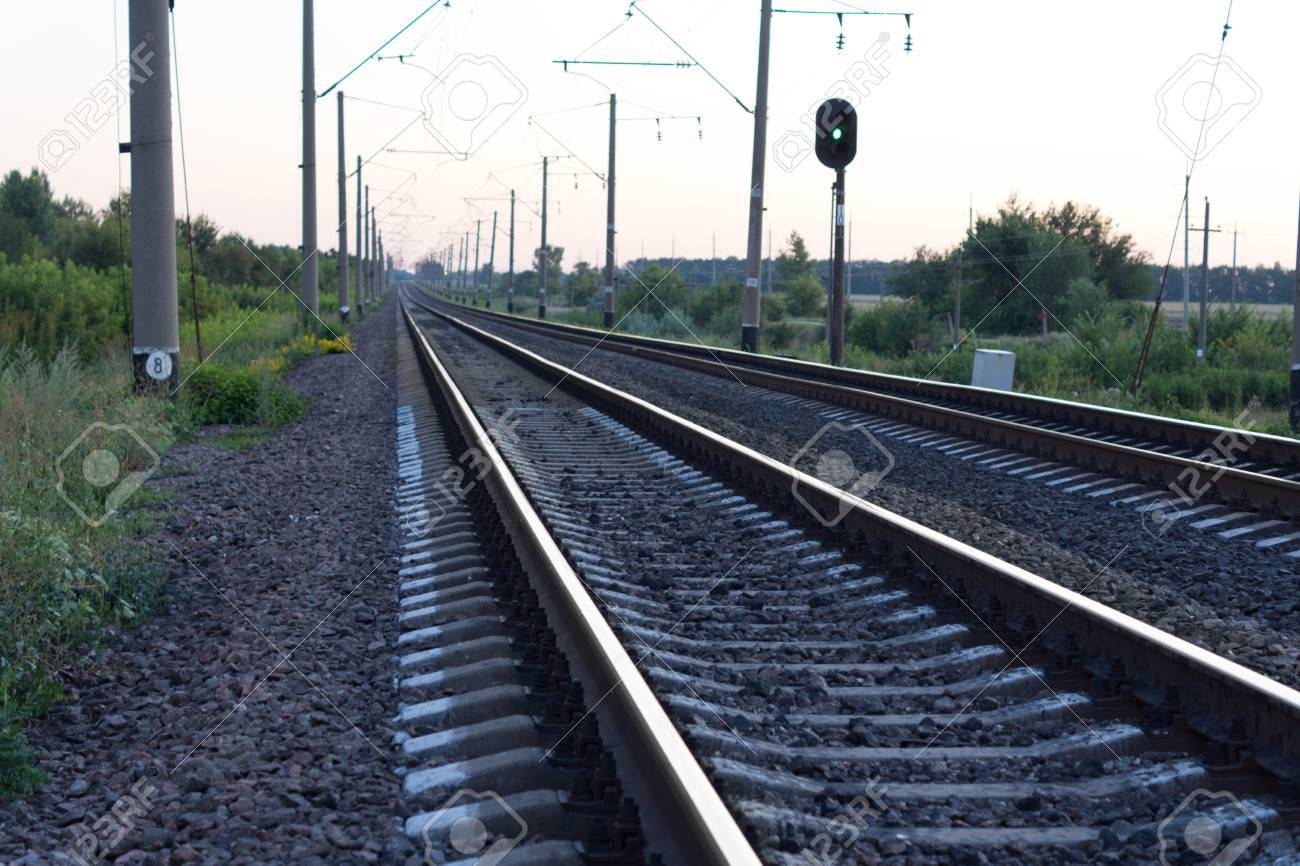 Oblique angle view of empty rural railway tracks disappearing